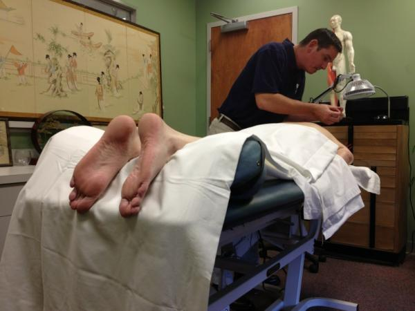 Bret working at the Institute for Acupuncture & Wellness